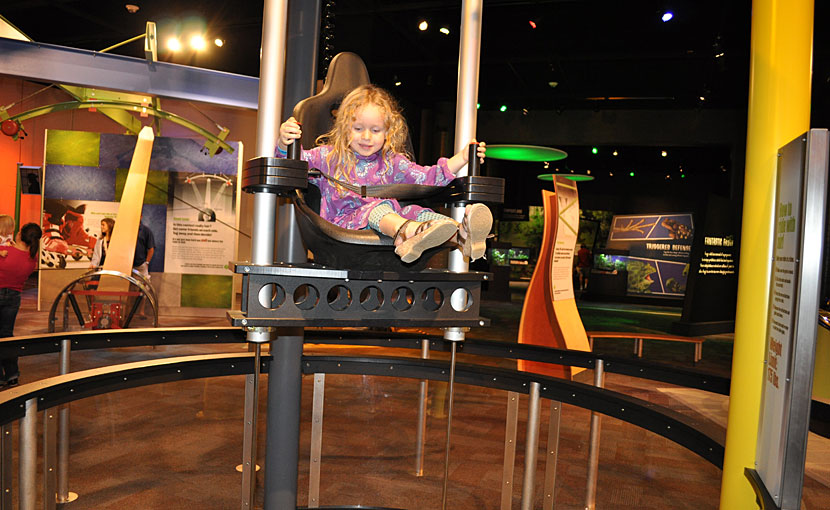 My daughter Reagan in the Air Chair at Discovery Place