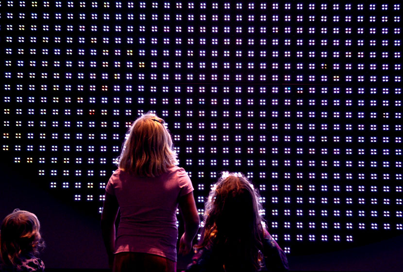 My daughters looking at an LED exhibit at Discovery Place